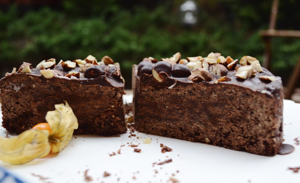 two halves of chocolate cake with hazelnuts