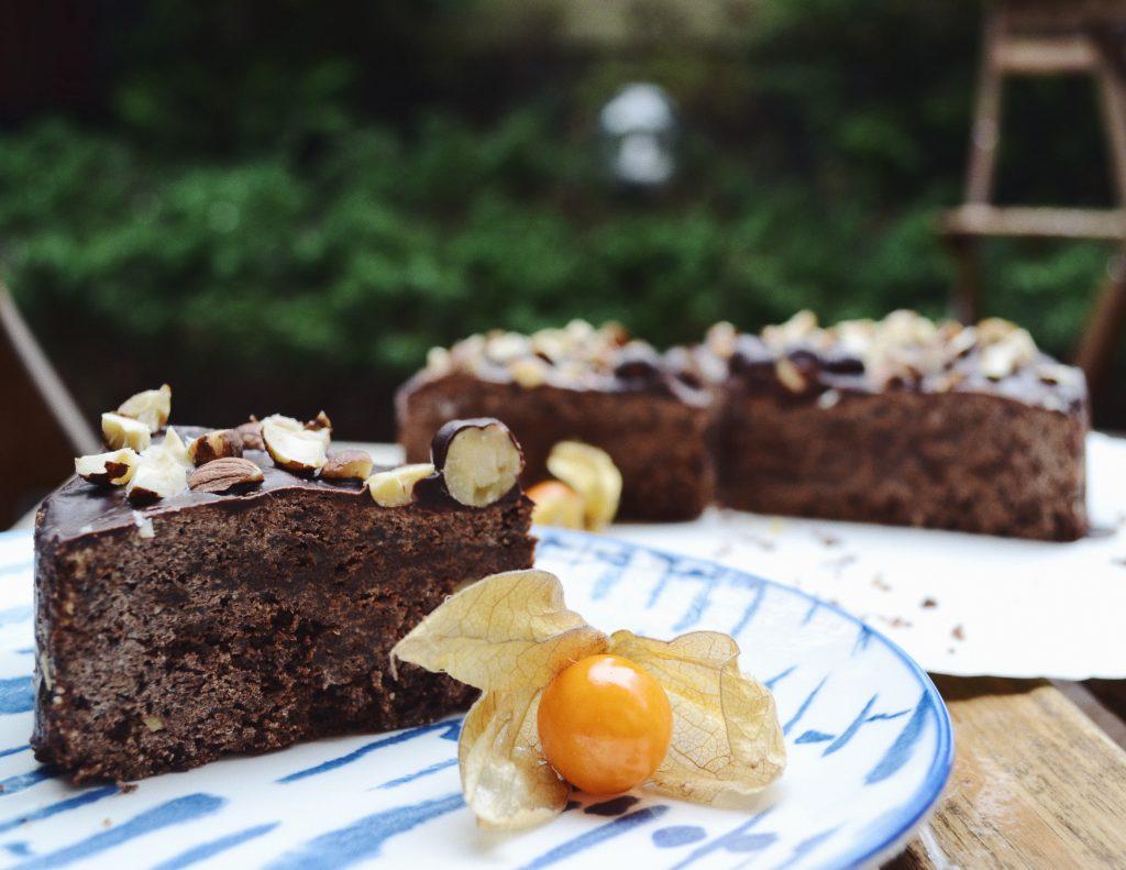 piece of chocolate hazelnut cake in a blue plate