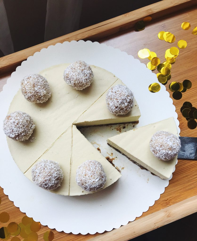cake decorated with raw coconut balls