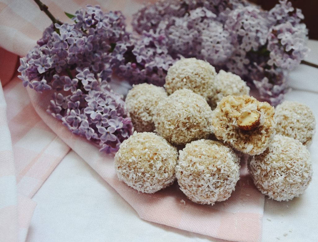 raw coconut balls with purple lilacs